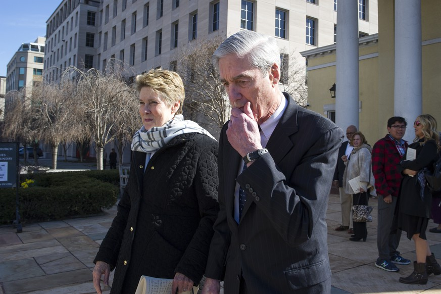 Special Councel Robert Mueller, and his wife Ann, depart St. John's Episcopal Church, across from the White House, in Washington, Sunday, March 24, 2019. Mueller closed his long and contentious Russia investigation with no new charges, ending the probe that has cast a dark shadow over Donald Trump's presidency. (AP Photo/Cliff Owen)