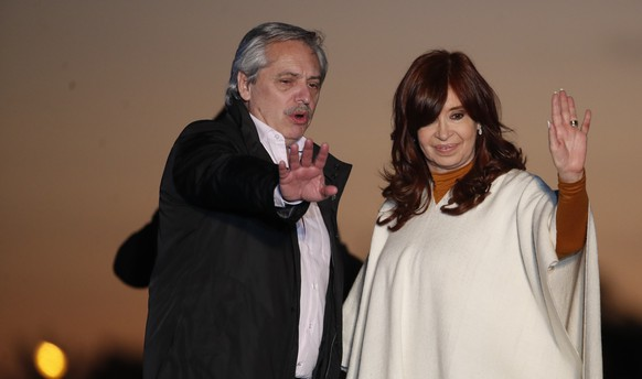 In this Oct. 17, 2019 photo, presidential candidate Alberto Fernandez, left, and running-mate Cristina Fernandez de Kirchner, wave to supporters at a campaign rally in Santa Rosa, Argentina. Fernandez de Kirchner retains immense popularity among Argentines who view her as a champion of the poor. (AP Photo/Natacha Pisarenko) Cristina Fernandez de Kirchner,Alberto Fernandez