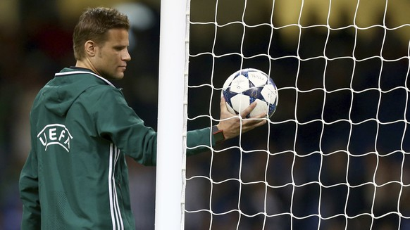 Referee Felix Brych tests the goal line technology before the Champions League final soccer match between Juventus and Real Madrid at the Millennium stadium in Cardiff, Wales Saturday June 3, 2017. (AP Photo/Dave Thompson)