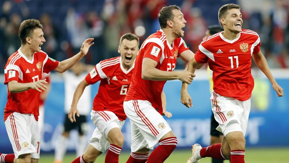 From left: Russia's Alexander Golovin, Denis Cheryshev, Artyom Dzyuba, and Roman Zobnin celebrate after Egypt's Ahmed Fathy scoring the own goal, the opening goal of the group A match between Russia and Egypt at the 2018 soccer World Cup in the St. Petersburg stadium in St. Petersburg, Russia, Tuesday, June 19, 2018. (AP Photo/Efrem Lukatsky)