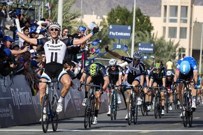 epa04059829 German rider Marcel Kittel (L) of the Giant-Shimano Team celebrates after crossing the finish line to win the third stage of the Dubai Tour 2014 cycling race over 162,3km from Dubai to Hatta in Dubai, United Arab Emirates, 07 February 2014.  EPA/ANGELO CARCONI