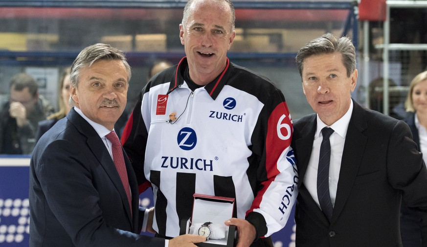 Rene Fasel, President of the International Ice Hockey Federation, IIHF, left, Danny Kurmann, referee, center, and Viatcheslav Arkadievitch
