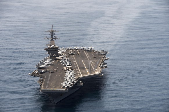 epa08335876 (FILE) - An aerial handout image made available by US Navy showing the aircraft carrier USS Theodore Roosevelt (CVN 71) operating in the Arabian Sea on 21 April 2015 (reissued 01 April 2020). According to reports,  Captain Brett Crozier, captain of the US aircraft carrier Theodore Roosevelt, which is currently docked in Gua, has penned a letter calling for decisive action to be taken to avert deaths on the carrier.  EPA/MC3 ANTHONY N. HILKOWSKI / HANDOUT   HANDOUT EDITORIAL USE ONLY HANDOUT EDITORIAL USE ONLY/NO SALES