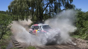 Mini driver Nasser Al-Attiyah of Qatar and co-pilot Matthieu Baumel of France, races during the eleventh stage of the Dakar Rally 2015 between the cities of Termas de Rio Hondo and Rosario, Argentina, Friday, Jan. 16, 2015. The race returned to Argentina after passing through Bolivia and Chile and will finish on Jan. 17 in Buenos Aires. (AP Photo/Felipe Dana)
