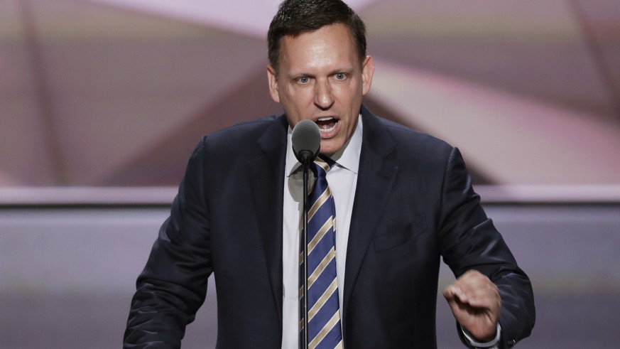FILE - In this  July 21, 2016, file photo, Entrepreneur Peter Thiel speaks during the final day of the Republican National Convention in Cleveland. The U.S. Department of Labor has filed a lawsuit accusing a fast-growing Silicon Valley software company of systematically discriminating against Asian job applicants. Palantir Technologies was co-founded by prominent tech financier Thiel, with backing from an investment arm of the CIA, and was recently valued at about $20 billion. Palantir denied the allegations Monday, Sept. 26, and said it will contest the suit. (AP Photo/J. Scott Applewhite, File)
