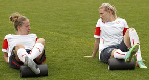 Switzerland's players Caroline Abbe, left, and Lara Dickenmann, right, stretch, during a training session of the national soccer team of Switzerland before the FIFA Women's world cup 2015 qualification soccer match between Switzerland and Iceland at the Colovray Stadium in Nyon, Switzerland, Tuesday, May 6, 2014. (KEYSTONE/Salvatore Di Nolfi)