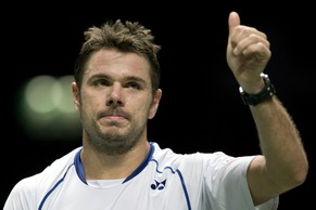 Stan Wawrinka of Switzerland gives a thumbs up after defeating Jesse Huta Galung of the Netherlands during their first round match of the 42nd ABN AMRO world tennis tournament at Ahoy Arena in Rotterdam, Netherlands, Wednesday, Feb. 11, 2015. Wawrinka won in three sets 6-3, 3-6, 6-3. (AP Photo/Peter Dejong)