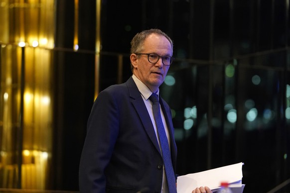 Peter Ben Embarek of a World Health Organization team arrives for a joint press conference at the end of their mission to investigate the origins of the coronavirus pandemic in Wuhan in central China's Hubei province on Tuesday, Feb. 9, 2021. (AP Photo/Ng Han Guan)