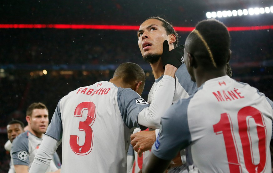 epa07435081 Virgil van Dijk of Liverpool (C) celebrates scoring the second goal during the UEFA Champions League round of 16 second leg soccer match between FC Bayern Munich and Liverpool FC in Munich, Germany, 13 March 2019.  EPA/RONALD WITTEK