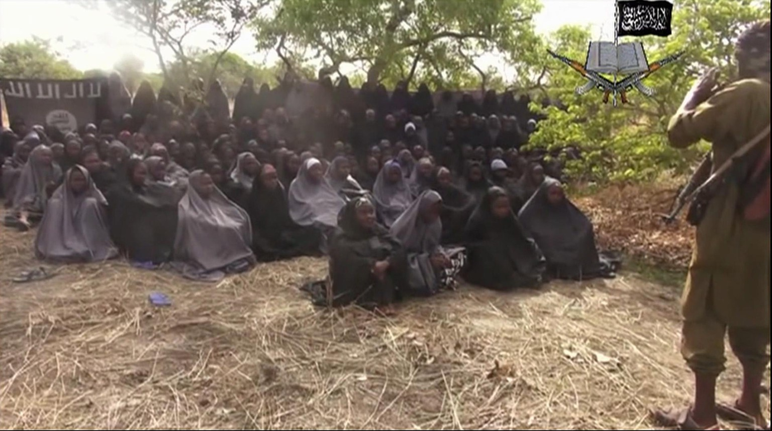 "FILE - This file photo taken from video by Nigeria's Boko Haram terrorist network, Monday, May 12, 2014, shows the missing girls alleged to be abducted April 14, from the northeastern town of Chibok. A Nigerian government official said ""all options are open"" in efforts to rescue the almost 300 abducted schoolgirls from their Islamic extremist captors as U.S. surveillance and reconnaissance aircraft started flying over the West African country. (AP Photo/File)"