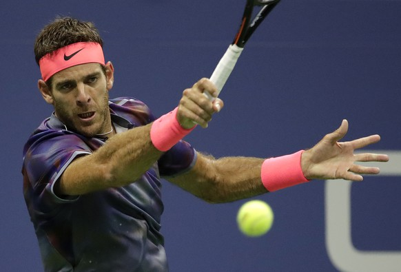 Juan Martin del Potro, of Argentina, hits a forehand to Roger Federer, of Switzerland, during the quarterfinals of the U.S. Open tennis tournament, Wednesday, Sept. 6, 2017, in New York. (AP Photo/Julio Cortez)