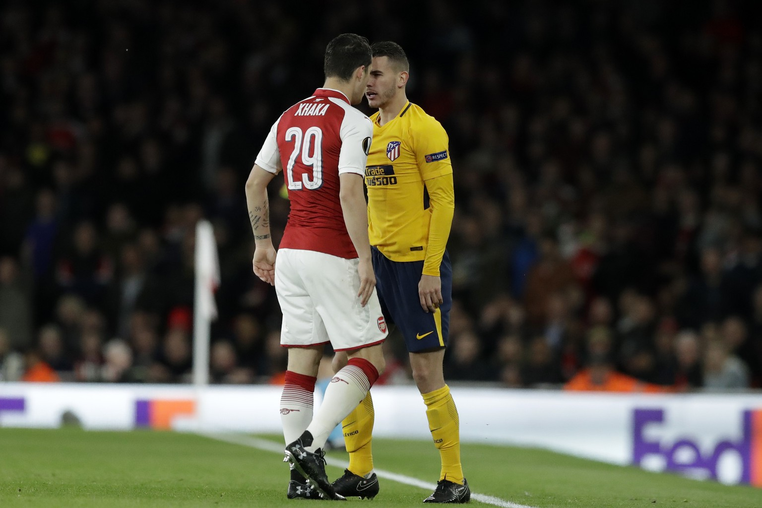 Arsenal's Granit Xhaka, left, argues with Atletico's Lucas Hernandez during the Europa League semifinal first leg soccer match between Arsenal FC and Atletico Madrid at Emirates Stadium in London, Thursday, April 26, 2018. (AP Photo/Matt Dunham)