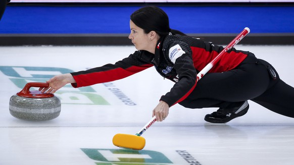 Canada skip Kerri Einarson releases a stone against Switzerland at the women's world curling championship in Calgary, Alberta, Saturday, May 1, 2021. (Jeff McIntosh/The Canadian Press via AP)