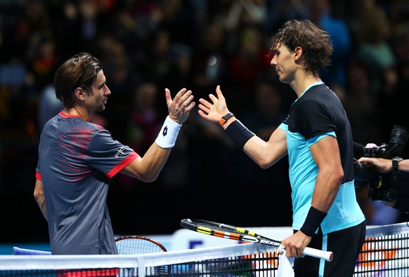 LONDON, ENGLAND - NOVEMBER 20:  (R-L) The victorious Rafael Nadal of Spain shakes hands with  David Ferrer of Spain following his victory during their men's singles match on day six of the Barclays ATP World Tour Finals at the O2 Arena on November 20, 2015 in London, England.  (Photo by Clive Brunskill/Getty Images)