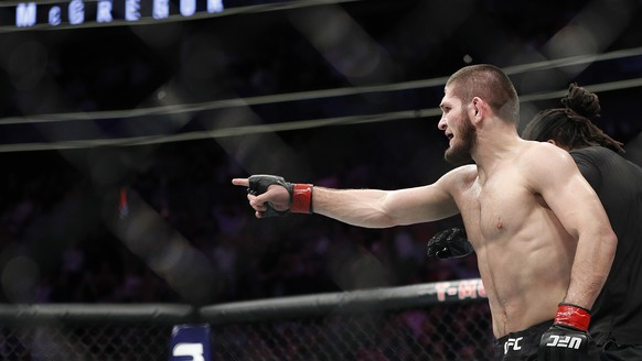 FILE - In this Oct. 6, 2018, file photo, Khabib Nurmagomedov gestures after fighting Conor McGregor during a lightweight title mixed martial arts bout at UFC 229 in Las Vegas, Saturday, Oct. 6, 2018. Nurmagomedov won the fight by submission during the fourth round to retain the title. Nurmagomedov and McGregor will remain suspended at least until December because of a brawl inside and outside the octagon after their UFC match in Las Vegas, but the Nevada Athletic Commission on Wednesday, Oct. 24, 2018, allowed some prize money to be released to Nurmagomedov. (AP Photo/John Locher, File)
