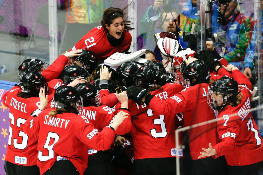 Team Switzerland celebrates their 4-3 win over Sweden in the women's bronze medal ice hockey game at the 2014 Winter Olympics, Thursday, Feb. 20, 2014, in Sochi, Russia. (AP Photo/Petr David Josek)