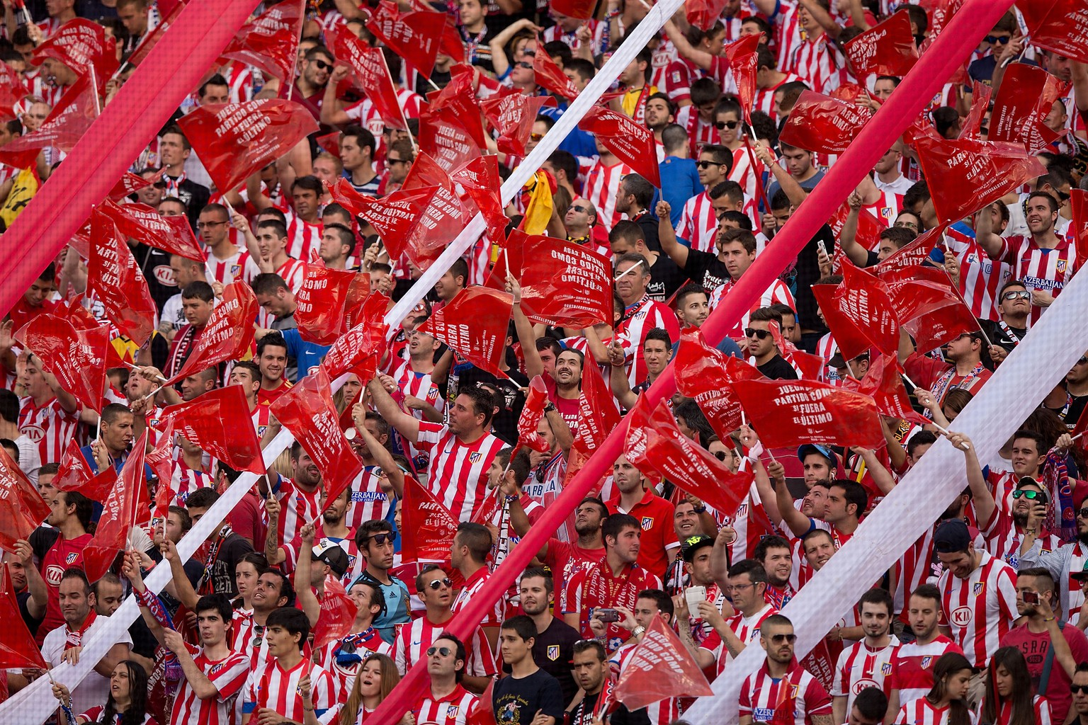 MADRID, SPAIN - MAY 11:  Atletico de Madrid fans wave red plastic flags supporting their team prior to start the La Liga match between Club Atletico de Madrid and Malaga CF at Vicente Calderon Stadium on May 11, 2014 in Madrid, Spain.  (Photo by Gonzalo Arroyo Moreno/Getty Images)
