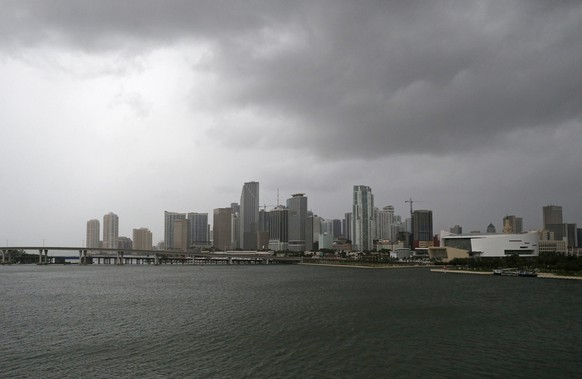 Clouds cover the Miami skyline as the outer bands of Hurricane Irma reached South Florida early Saturday, Sept. 9, 2017 in Miami. Gov. Rick Scott is urging anyone living in an evacuation zone in southwest Florida to leave by noon as the threat of Hurricane Irma has shifted west.  (David Santiago/Miami Herald via AP)