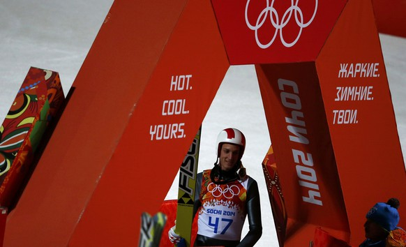 Austria's Gregor Schlierenzauer reacts after his jump in the final round of the men's ski jumping large hill individual final of the Sochi 2014 Winter Olympic Games, at the RusSki Gorki Ski Jumping Center in Rosa Khutor, February 15, 2014. REUTERS/Dominic Ebenbichler (RUSSIA  - Tags: SPORT SKIING OLYMPICS)