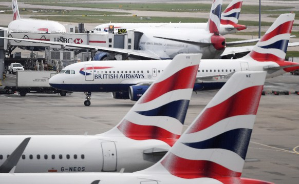 epa08293889 British Airways passenger aircraft at Heathrow Airport Terminal Five in London, Britain, 14 March 2020. The future of British Airways and other airlines is under threat as global travel is significantly down due to the Coronavirus. The International Air Transport Association (IATA) on 13 March said losses of global airliners will likely exceed its earlier estimate of 113 billion US dollars.  EPA/ANDY RAIN