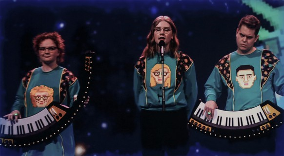 Dadi og Gagnamagnid from Iceland perform via video link during rehearsals at the Eurovision Song Contest at Ahoy arena in Rotterdam, Netherlands, Wednesday, May 19, 2021. A member of Dadi og Gagnamagnid tested positive for COVID-19 and the band made the decision to withdraw from performing in this year's live Eurovision Song Contest shows, as they only want to perform together as a group. (AP Photo/Peter Dejong) Dadi og Gagnamagnid