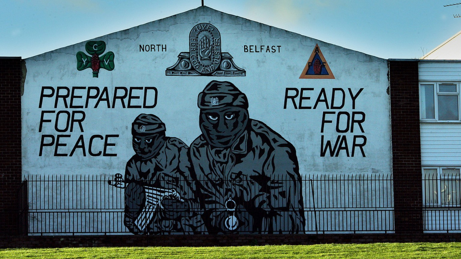 An Ulster Volunteer Force (UVF) mural is seen in north Belfast, Northern Ireland, Monday Jan. 22, 2007. An investigation into collusion between Belfast police and Protestant outlaws has found damning evidence that senior detectives shielded killers from prosecution because they were providing information, Northern Ireland's secretary of state Peter Hain said Monday.  (AP Photo/Peter Morrison)