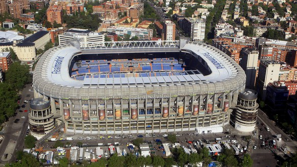 epa04495521 (FILE) A file picture dated 21 May 2010 of an aerial view of Santiago Bernabeu stadium in Madrid, Spain. The fans of Real Madrid are not pleased with the plan to rename the club's legendary Estadio Bernabeu, to judge by an online poll taken on 18 November 2014. Real Madrid President Florentino Perez has been planning to put a commercial name on the 67-year-old stadium for several months now.  EPA/ZIPI *** Local Caption *** 50776510