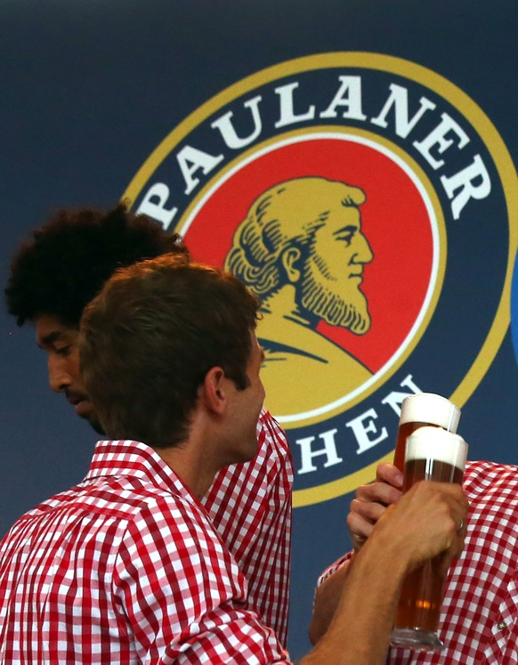 MUNICH, GERMANY - AUGUST 31:  (L-R) Dante, Thomas Mueller, Bastian Schweinsteiger and Robert Lewandowski of Bayern Muenchen attend the FC Bayern Muenchen Paulaner photo shoot in traditional Bavarian lederhosen at Bayern Muenchen's headquarter Saebener Strasse on August 31, 2014 in Munich, Germany.  (Photo by Alexander Hassenstein/Bongarts/Getty Images)