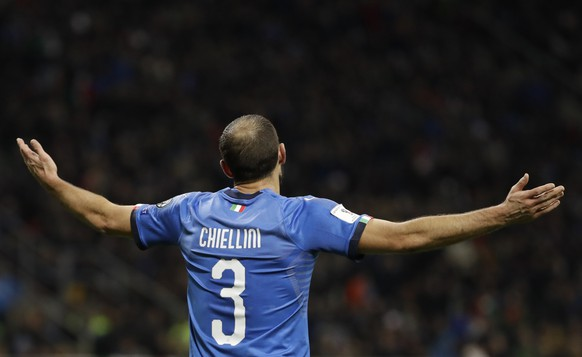 Italy's Giorgio Chiellini gestures in despair after the referee awarded a free kick to Sweden during the World Cup qualifying play-off second leg soccer match between Italy and Sweden, at the Milan San Siro stadium, Italy, Monday, Nov. 13, 2017. (AP Photo/Luca Bruno)
