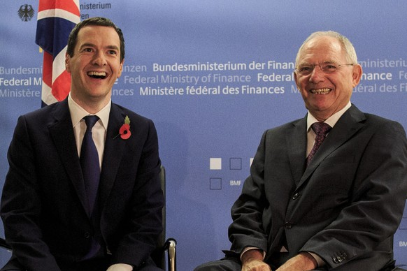 BERLIN, GERMANY - NOVEMBER 02:  German Finance Minister Wolfgang Schaeuble (R) and British Chancellor of the Exchequer George Osborne laughing to the press upon Osborne's arrival at the Ministry of Finance on November 2, 2015 in Berlin, Germany. Osborne is meeting with Schaeuble to get German backing on renegotiating Britain's membership in the European Union.  (Photo by Carsten Koall/Getty Images)