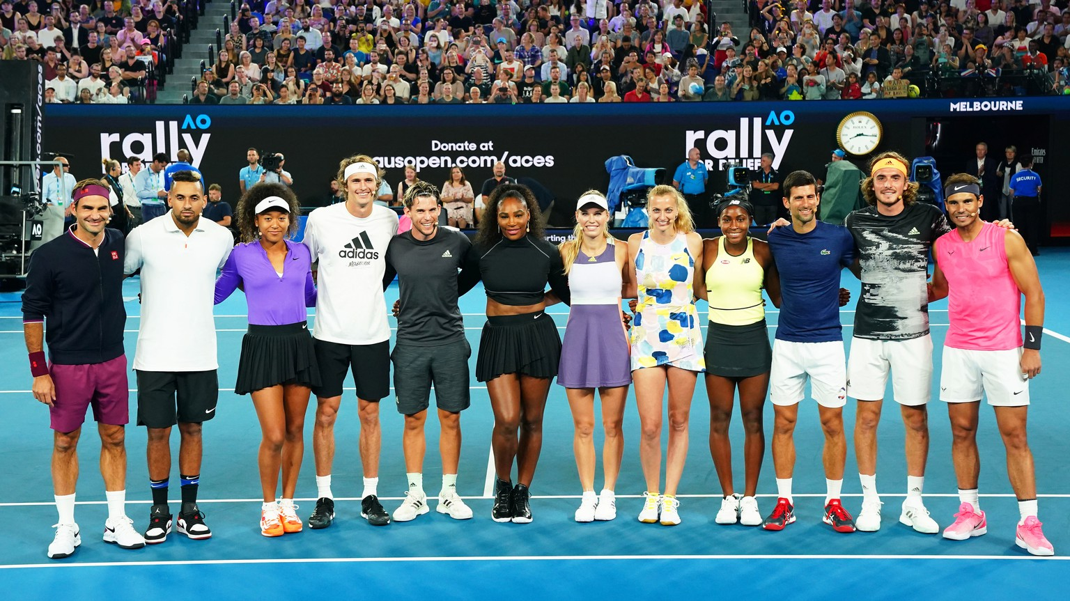epa08129578 (L-R) Roger Federer of Switzerland, Nick Kyrgios of Australia, Naomi Osaka of Japan, Alexander Zverev of Germany, Dominic Thiem of Austria, Serena Williams of the USA, Caroline Wozniacki of Denmark, Petra Kvitova of the Czech Republic, Coco Gauff of the USA, Novak Djokovic of Serbia, Stefanos Tsitsipas of Greece, and Rafael Nadal of Spain pose for photographers during the Rally For Relief at Rod Laver Arena in Melbourne, Australia, 15 January 2020. Sports people and entertainers have come together for the Rally for Relief at Rod Laver Arena in Melbourne to raise money for bushfire relief efforts across Australia.  EPA/SCOTT BARBOUR AUSTRALIA AND NEW ZEALAND OUT