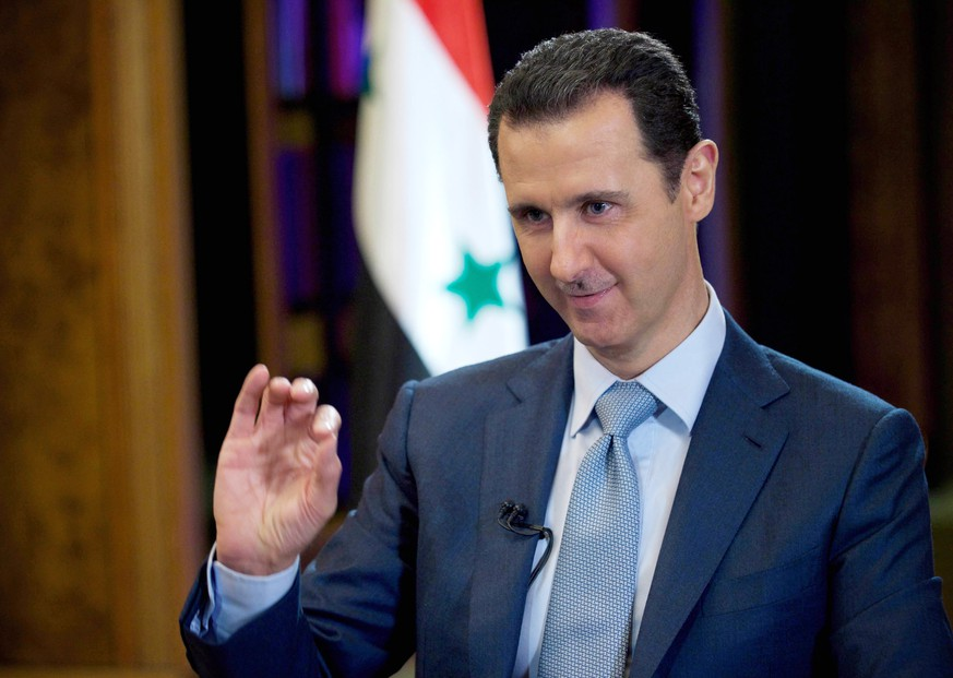 FILE - In this Tuesday, Feb. 10, 2015 file photo released by the Syrian official news agency SANA, Syrian President Bashar Assad gestures during an interview with the BBC, in Damascus, Syria. Assad says he would be