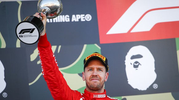 epa07916961 German Formula One driver Sebastian Vettel of Scuderia Ferrari celebrates on the podium with his trophy after finishing second in the Japanese Formula One Grand Prix in Suzuka, Japan, 13 October 2019. EPA/DIEGO AZUBEL