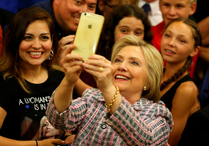 U.S. Democratic presidential candidate Hillary Clinton takes a picture with supporters during a campaign stop in Sacramento, California, United States June 5, 2016.   REUTERS/Mike Blake