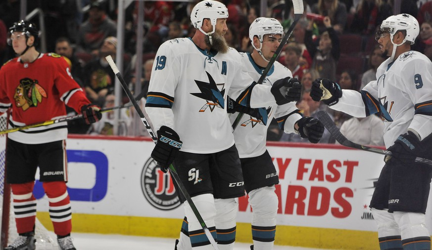 San Jose Sharks' Evander Kane (9) celebrates with teammates Joe Thornton (19) and Timo Meier (28) of the Czech Republic, after scoring a goal during the first period of an NHL hockey game against the Chicago Blackhawks Wednesday, March 11, 2020, in Chicago. (AP Photo/Paul Beaty)
