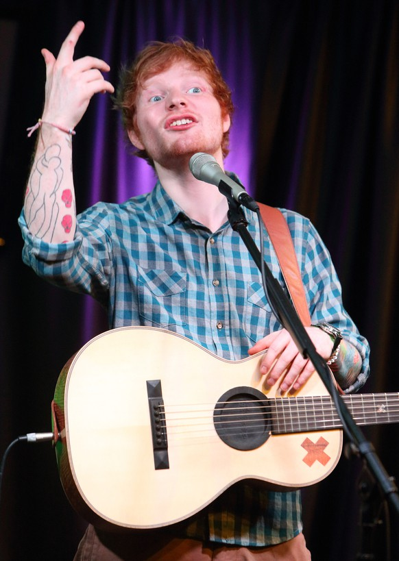 Singer-songwriter Ed Sheeran visits the radio Q102 Performance Theater on Friday, July 4, 2014, in Philadelphia. (Photo by Owen Sweeney/Invision/AP)
