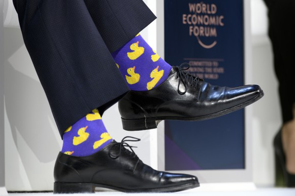 Justin Trudeau, Prime Minister of Canada, sports duck socks are pictured during a plenary session in the Congress Hall during the 48th Annual Meeting of the World Economic Forum, WEF, in Davos, Switzerland, Thursday, January 25, 2018. The meeting brings together entrepreneurs, scientists, corporate and political leaders in Davos, January 23 to 26. (KEYSTONE/Laurent Gillieron)