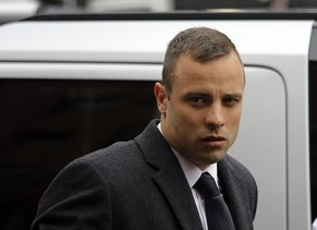 epa04166827 South African Paralympic athlete Oscar Pistorius arrives at court prior to another day of cross examination during his ongoing murder trial, in Pretoria, South Africa, 14 April 2014. Pistorius stands trial for the premeditated murder of his model girlfriend Reeva Steenkamp in February 2013.  EPA/KIM LUDBROOK