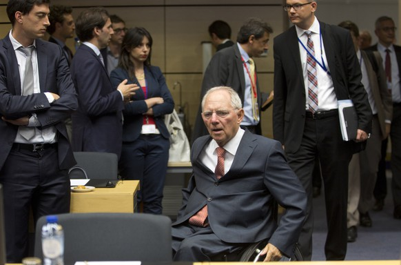 German Finance Minister Wolfgang Schaeuble, center, arrives for a meeting of eurozone finance ministers at the EU Lex building in Brussels on Saturday, July 11, 2015. Greece's negotiators head to Brussels on Saturday armed with their reform proposals and parliamentary backing to seek a third bailout, but with the shadow of severe dissent from governing lawmakers hanging over them. (AP Photo/Virginia Mayo)