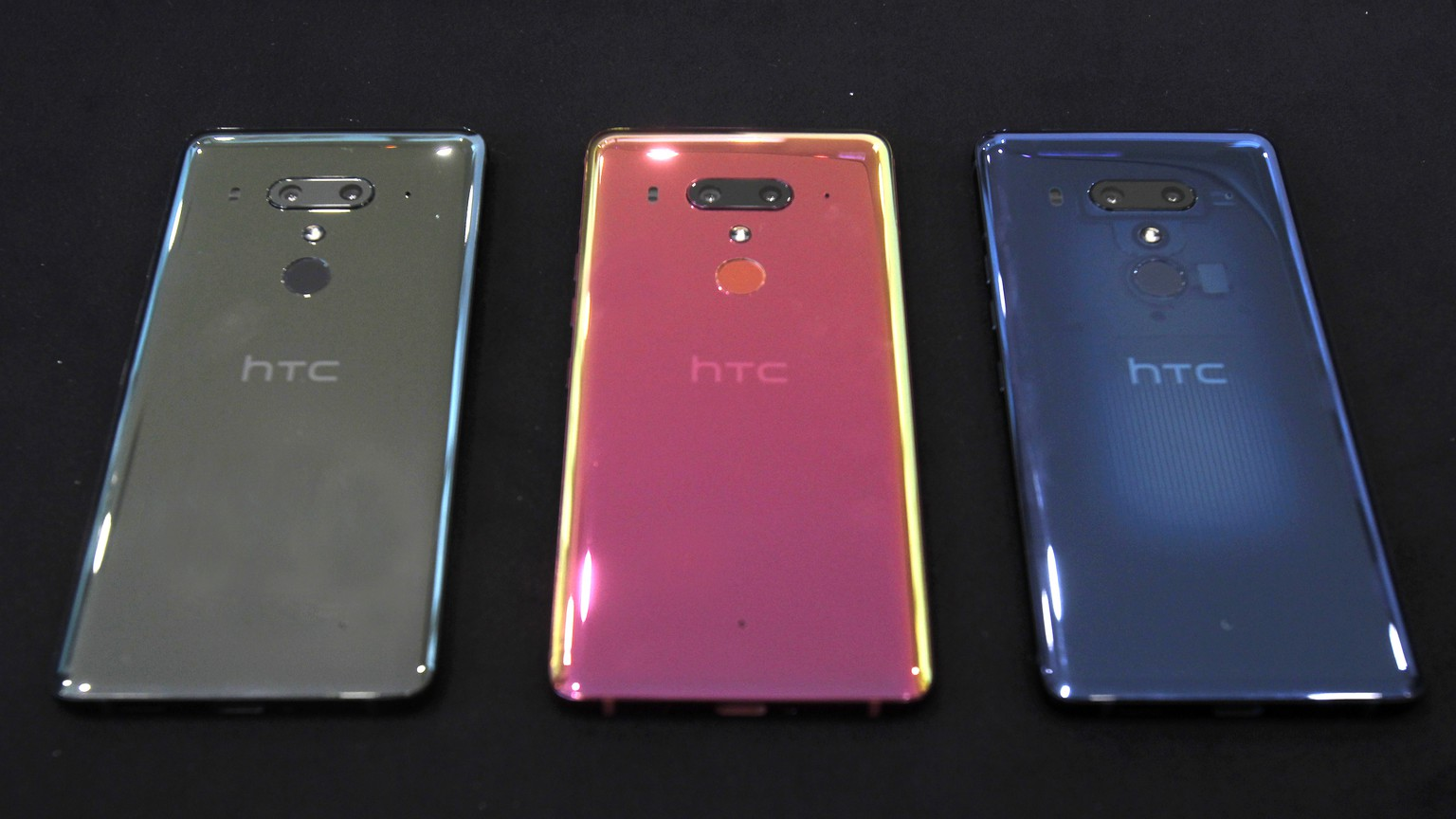 This photo shows three colors of HTC U12+ smart phones during a media event in Taipei, Taiwan, Wednesday, May 23, 2018. The HTC U12+ sell for NT$23,900 (6GB RAM / 64GB ROM, US$797) and NT$24,900 (6GB RAM / 128GB ROM, $830) respectively in Taiwan. (AP Photo/Chiang Ying-ying)