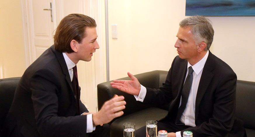 Austrian Foreign Minister Sebastian Kurz, left, meets for talks with Switzerland's Federal President Didier Burkhalter, right, in Vienna, Austria, Friday, Jan. 17, 2014. (AP Photo/Ronald Zak)
