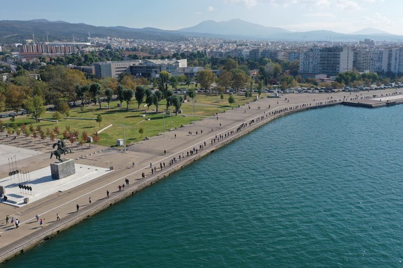 epa08782577 A photo taken with drone shows citizens queuing for free COVID-19 rapid tests that are provided throughout the day by Hellenic National Public Health Organization, in Thessaloniki, Greece, 29 October 2020. In a further steep record rise of infections, Greece confirmed 1,547 new coronavirus cases on Wednesday, from 1,259 on Tuesday.  EPA/DIMITRIS TOSIDIS