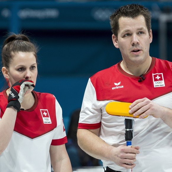 Jenny Perret of Switzerland and Martin Rios of Switzerland, from left, in action during the Mixed Doubles Curling round robin game between Switzerland and Finland one day prior to the opening of the XXIII Winter Olympics 2018 in Gangneung, South Korea, on Thursday, February 08, 2018. (KEYSTONE/Alexandra Wey)
