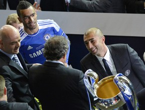 Chelsea coach Roberto Di Matteo, right, looks at UEFA president Michel Platini as he holds the trophy at the end of the Champions League final soccer match between Bayern Munich and Chelsea in Munich, Germany Saturday May 19, 2012. Chelsea's Didier Drogba scored the decisive penalty in the shootout as Chelsea beat Bayern Munich to win the Champions League final after a dramatic 1-1 draw on Saturday. (AP Photo/Kerstin Joensson)