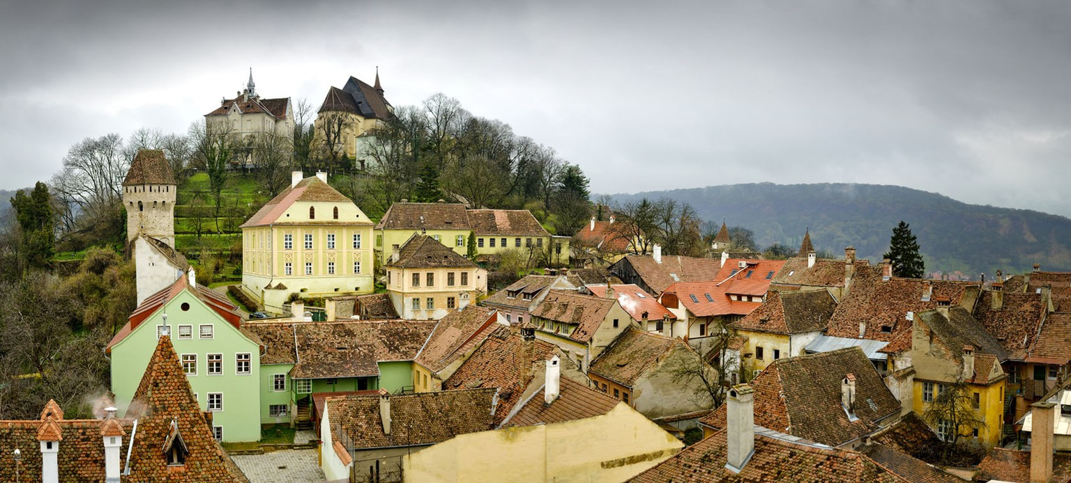 Panorama on a moody day with dramatic sky, Sighisoara, mediaval town in Transylvania, Romania