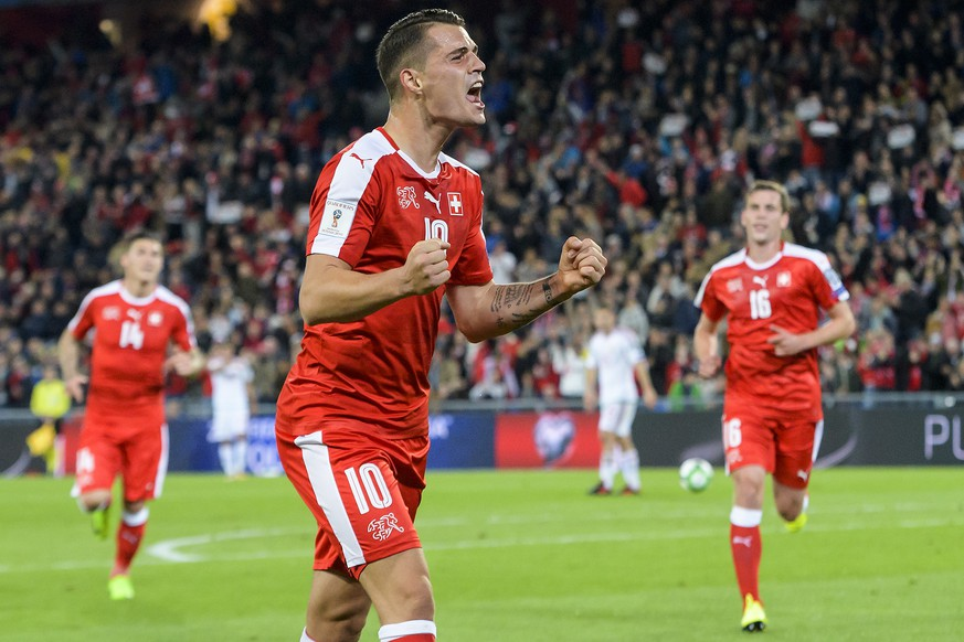 Switzerland's Granit Xhaka, celebrates after scoring the 1:0, during the 2018 Fifa World Cup Russia group B qualification soccer match between Switzerland and Hungary in the St. Jakob-Park stadium in Basel, Switzerland, on Saturday, October 7, 2017. (KEYSTONE/Jean-Christophe Bott B qualification soccer match between Switzerland and Hungary in the St. Jakob-Park stadium in Basel, Switzerland, on Saturday, October 7, 2017. (KEYSTONE/Jean-Christophe Bott)