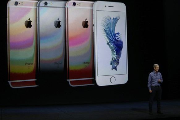 epa04922731 Apple CEO Tim Cook speaks about the new iPhone 6S and 6S Plus at an Apple launch event at the Bill Graham Civic Auditorium in San Francisco, California, USA, 09 September 2015. Media reports indicate a launch of updated iPhone models, updated iPads and a new Apple TV are expected at the event titled in an invitation from Apple as 'Hey Siri, give us a hint.'  EPA/MONICA DAVEY