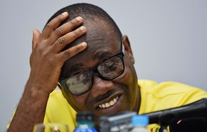 President of The Ghana Football Association, Kwesi Nyantakyi reacts as he answers questions during a press conference in Maceio on June 23, 2014, during the 2014 FIFA World Cup. Nyantakyi gave an interview stating they will sue the UK's Daily Telegraph newspaper over its claim he agreed for the national team to play in two proposed matches which he would