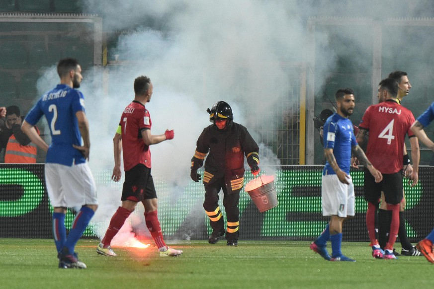 epa05868938 A flare on the field, thrown from the section of supporters of Albania, during the FIFA World Cup 2018 qualifying soccer match Italy vs Albania at Renzo Barbera stadium in Palermo, Sicily island, Italy, 24 March 2017.  EPA/MIKE PALAZZOTTO