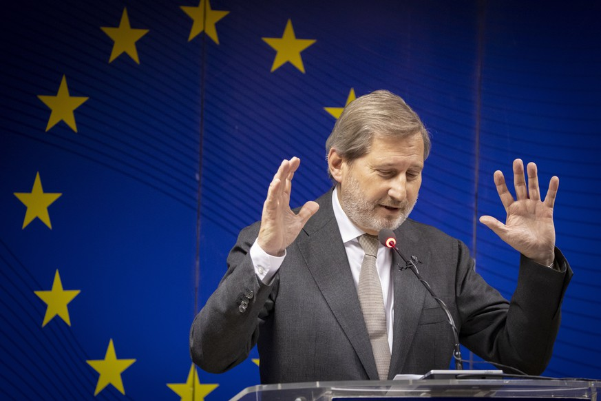 epa07206483 EU commissioner for Enlargement Negotiations Johannes Hahn gestures during a press conference following his meetings with local leaders in Pristina, Kosovo, 03 December 2018. EU commissioner for Enlargement Negotiations Johannes Hahn is in Kosovo for an official visit.  EPA/VALDRIN XHEMAJ
